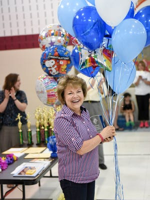 Educator of the Year Esther Burgett smiles as she is honored on Thursday, May 28, 2015, during an Educator of the Year celebration held at Olmsted Elementary School.