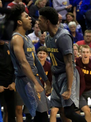Arizona State guards Remy Martin (1) and Shannon Evans II (11) celebrate after a basket during the second half of an NCAA college basketball game against Kansas in Lawrence, Kan., Sunday, Dec. 10, 2017.