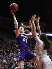 Indianola senior Grace Berg tries to get a shot over