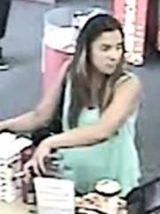The woman, who police suspect took part in an armed Phoenix burglary, captured on tape using a stolen credit card in May.