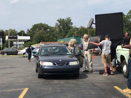 Production crew look on as actors Blythe Danner, left,