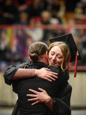 St. Cloud State University graduate Jessica Kisner hugs her sister Sgt. Kaitlyne Kisner during graduation ceremonies Friday, Dec. 16, at Halenbeck Hall in St. Cloud. Kaitlyne Kisner has been serving in the U.S. Army in Italy. She hadn't seen her sister in more than a year, before her surprise appearance Friday to hand Jessica her diploma.