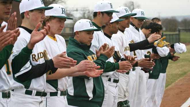 The Piscataway Tech baseball team applauds during a brief ceremony to dedicate their new field, before their game against Perth Amboy Tech.