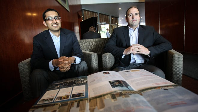Raghav Singhania (left) and Scott Murphy are part of a JPMorgan Chase program to assist in the rebuilding of Detroit.