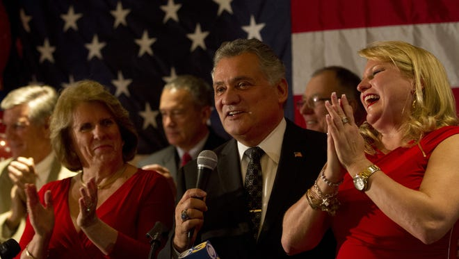 Freeholder Joseph H. Vicari declares victory on election night last year with his wife Joyce (left), and campaign manager and daughter Dina Vicari (right) at the Toms River Hotel.