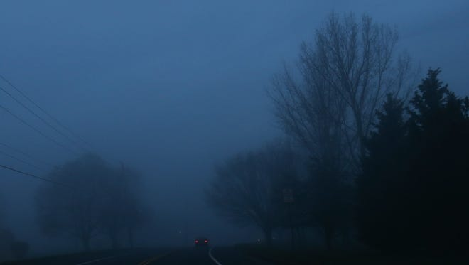 Fog covers McKennans Church Road at Delcastle Park Monday morning. A dense fog advisory is in effect for Delaware until 10am Monday.