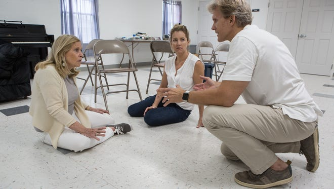 Actor/Director, Grant Aleksander, coaches actresses, Tina Sloan, left, and Cynthia Watros through a scene during a rehearsal of Breathing Under Dirt at St. Mary's Church in Pocomoke City on Tuesday, Aug 9, 2016.