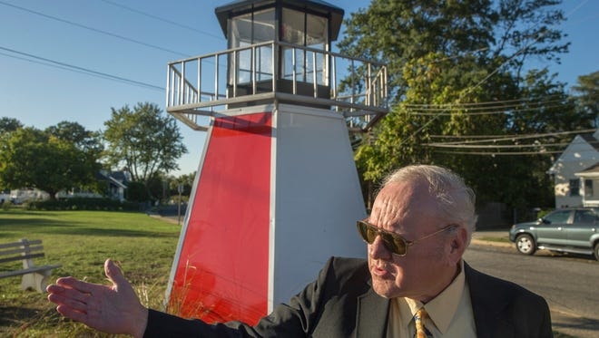 Edward D. Balyk, Keansburg Historical Society president in front of the replica Lighthouse.