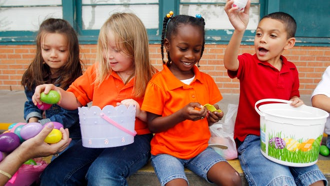 Kindergartners Olivia Garza (from left), Morgan Tullos, Maesha Brown and Javari Ayala coun, open up and show off their eggs Wednesday, April 20, 2011 during an Easter egg hunt at Carroll Lane Elementary in Corpus Christi. The three kindergarten classes participated in the hunt, with volunteers from Lexington Baptist Church helping to organize and donate some of the eggs.