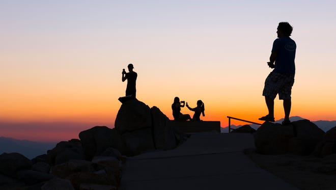Tourists grab shots of the sunset at Keys View in Joshua Tree National Park.