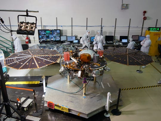 Workers in a clean room at the Lockheed Martin satellite
