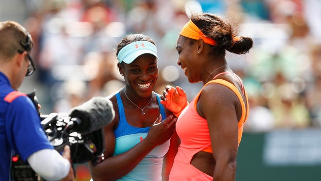Sloane Stephens congratulates Serena Williams during day nine of the BNP Paribas Open tennis at the Indian Wells Tennis Garden on March 17, 2015 in Indian Wells, Calif.