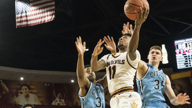 ASU's Shannon Evans goes for a basket against Citadel's Brian White (left) and Zane Najdaw during the second half at Wells Fargo Arena on Nov. 23, 2016.