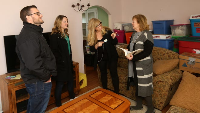 First time home buyers, from left, Brenden and  Jessica  Griswold, and real estate agents Jodine Utter and Wendy Callin.