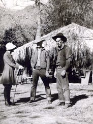 Dr. Florilla White and two actors playing cowboys in