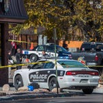 The rear window of a Colorado Springs Police car is shattered after a shooting Oct. 31, 2015, in Colorado Springs, Colo.