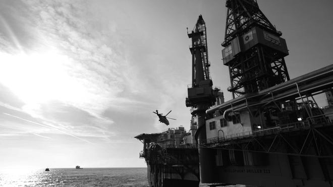 GULF OF MEXICO - MAY 11: A helicopter takes off from the helipad of the Development Driller III, which is drilling the relief well at the site of the Deepwater Horizon oil spill May 11, 2010 off the coast of Louisiana in the Gulf of Mexico. Oil is still leaking out of the Deepwater Horizon wellhead at a estimated rate of 1,000-5,000 barrels a day. (Photo by Gerald Herbert-pool/Getty Images)