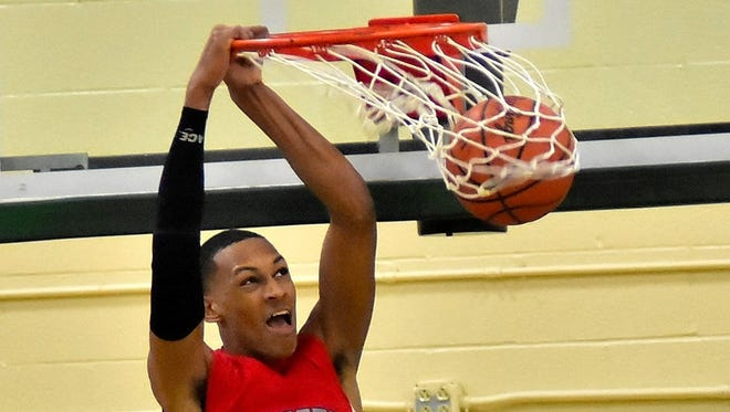 Princeton's Darius Bazley likes what he sees as he slams home his first dunk of the season for the Vikings, Dec. 8, 2017.