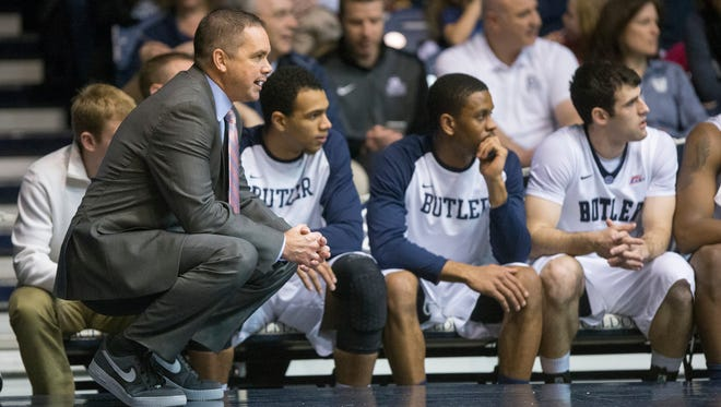 Butler coach Chris Holtmann watches action from the sideline in sneakers he wore in support of a Coaches vs. Cancer fundraising effort during Butler's game against Seton Hall on Jan. 25, 2015, Butler won 77-57.