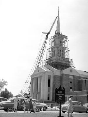 Carefully, almost reverently, this 8,500-pound cast bronze steeple was hoisted atop the Second Presbyterian Church's new sanctuary at Poplar and Goodlett on 3 June 1952.  The ticklish job was performed by S.@ W. Construction Co., which is erecting the $850,000 church building.  Completion of the structure is expected by early fall.