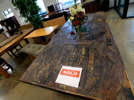 A table that was bought by a customer awaits pickup