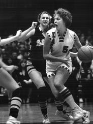1980: Lorri Bauman drives against Bettendorf's Lisa