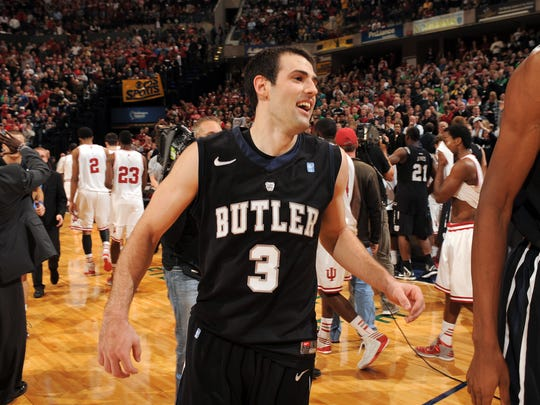 Butler's Alex Barlow is all smiles as he leaves the court after hitting the game- winning shot in the Bulldogs' 88-86 overtime win over top-ranked Indiana in the Crossroads Classic at Bankers Life Fieldhouse on Dec, 15, 2012.
