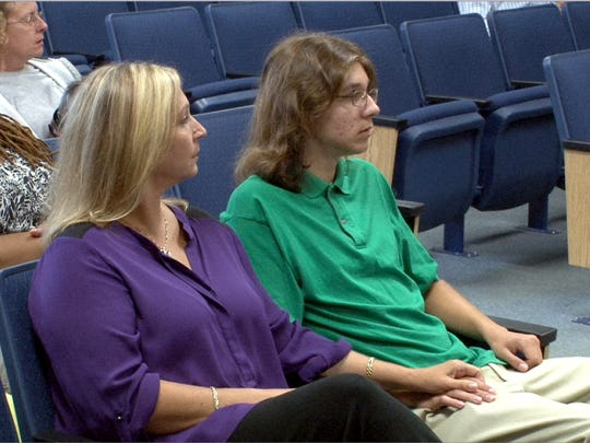 Parker Drake sits in the Manasquan municipal courtroom Tuesday, September 22, 2015, along with his mother Christine Marshall.  Christopher Tilton and Nicholas Formica are accused of coaxing the autistic teen to jump off the jetty in Manasquan over the winter.