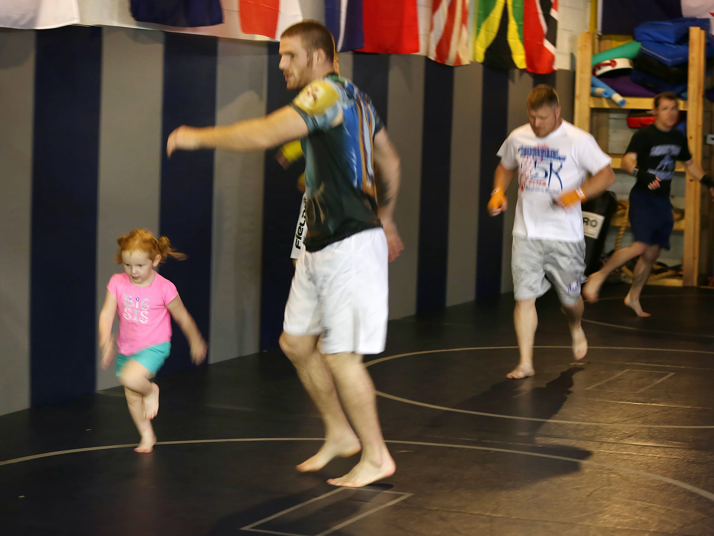 Savannah Holbrook, 3, ran laps with her father, local MMA fighter Andrew Holbrook in July.