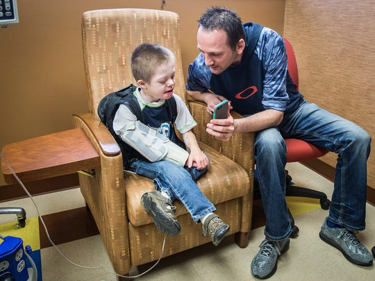 Joey Butterfield, 13, sits at Peyton Manning Children's