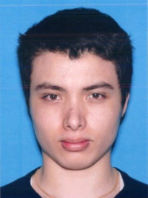 This undated file photo from the California Department of Motor Vehicles shows the driver license photo of Elliot Rodger, 22, who went on a murderous rampage Friday, May 23, 2014.