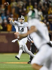 Michigan State QB Brian Lewerke passes the ball during