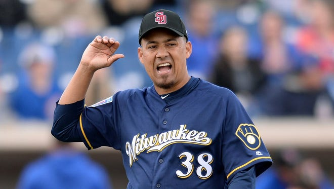 Brewers relief pitcher Ernesto Frieri celebrates after recording the final out in an inning against the Chicago Cubs in a recent spring training game.