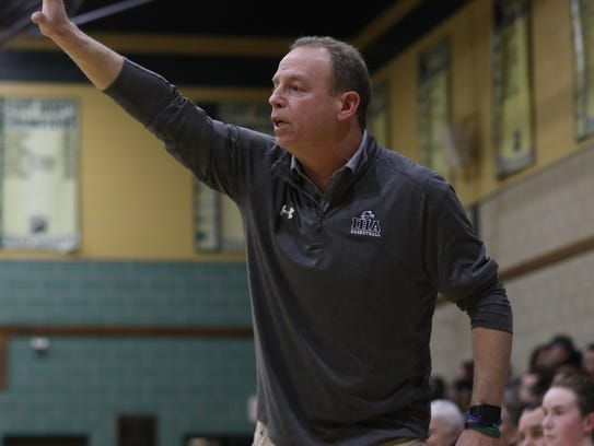 IHA coach Steve Silver calls out plays to his team.