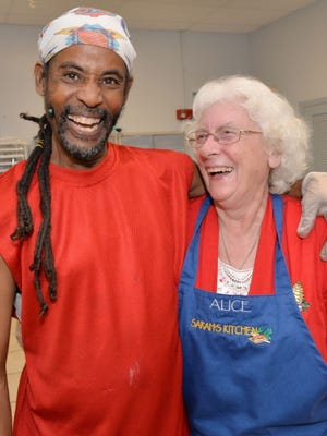 Sarah's Kitchen volunteers Charlton Price, left, and Alice West prepare to serve at last year's Christmas dinner at Notre Dame Church in Fort Pierce.