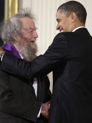 FILE - In this March 2, 2011, file photo, President Barack Obama presents a 2010 National Medal of Arts to poet Donald Hall, during in a ceremony in the East Room of the White House in Washington. Hall, a prolific, award-winning poet and man of letters widely admired for his sharp humor and painful candor about nature, mortality, baseball and the distant past, has died at age 89. Hall's daughter, Philippa Smith, confirmed Sunday, June 24, 2018, that her father died Saturday at his home in Wilmot, New Hampshire, after being in hospice care for some time. (AP Photo/Charles Dharapak, File)