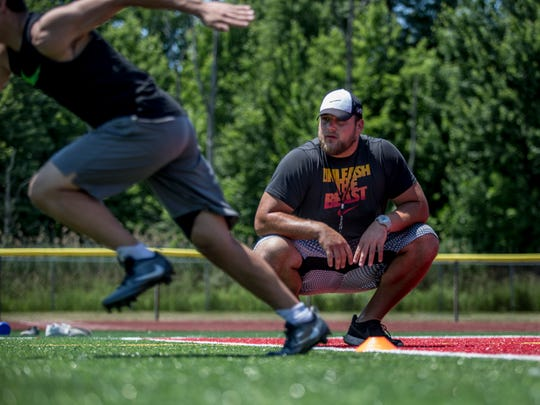 New Orleans Saints offensive lineman and St. Clair High School graduate Tim Lelito watches as he helps kids with their form while sprinting during Lelito's Legacy Camp Friday, June 24, 2016 at the East China Stadium.