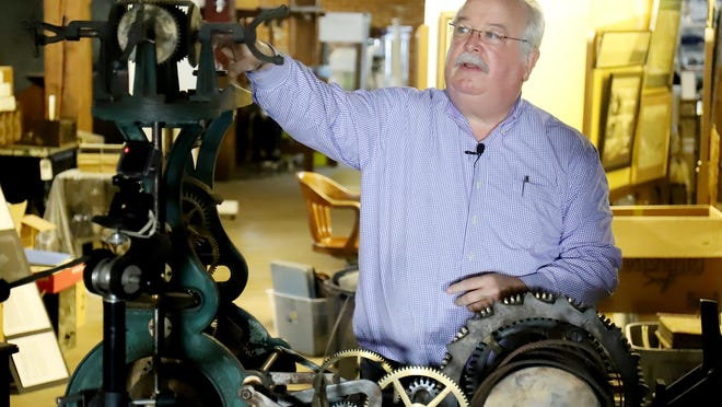 """Chuck Girard, Fort Smith Museum of History collections manager, talks about the second hand mechanism pulleys and gears in the 1888 Sebastian County Court House clock during video production, Tuesday, August 4, 2020, for the upcoming FSMH """"Un-Masked,"""" un-event, September 26, 2020. Caroline Speir, FSMH executive director, said that the un-attend fundraiser is in respect of social distancing and offers museum patrons an opportunity to support the museum during the COVID-19 pandemic."""