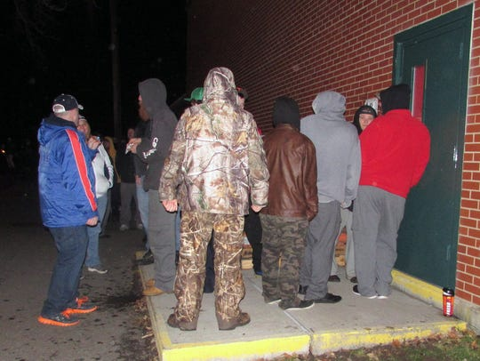 People stand in line outside Arctic League headquarters