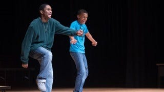 """TaDarius Hall, a sophomore at Pensacola High School, practices for the spring musical """"Anything Goes,"""" a production that will be put on by the Theatre Troop 4760. In the background is Justin Polk, also a sophomore."""