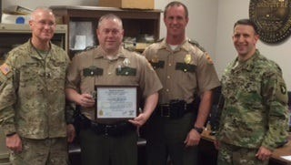 THP Trooper Vincent Meaker was recently honored by the Army for saving a soldier's life by pulling him from a burning pickup last year