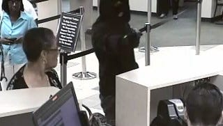 Irondequoit police released this photo of a hold-up that occurred at ESL Federal Credit Union at 518 E. Ridge Road on Monday, June 20, 2016.