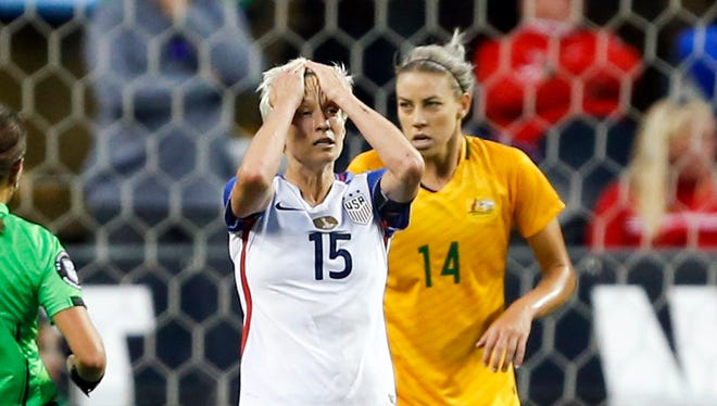 USA midfielder Megan Rapinoe (15) reacts following a failed free kick attempt by a teammate during the second half against Australia at CenturyLink Field.