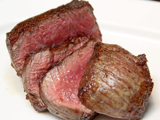 A crust is seared onto the filet at downtown steakhouse Carnevor, 718 N. Milwaukee St.