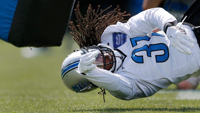 Detroit Lions cornerback Rashean Mathis dives during a drill at training camp in Allen Park on Aug. 4, 2015.