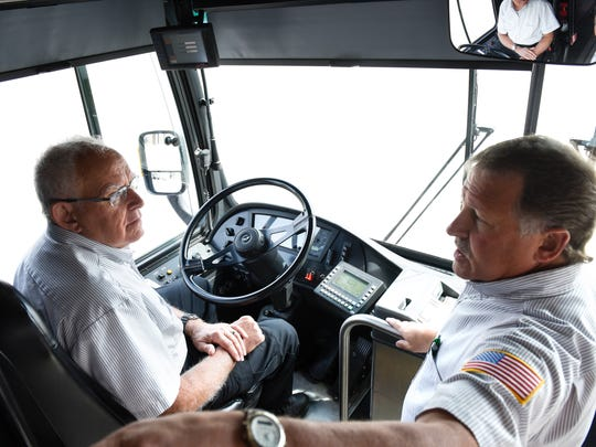 Dale Mossey talks with Dean Henkemeyer of Metro Bus during a training session Wednesday, June 8, at the Metro Bus Operations Center in St. Cloud.