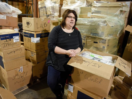Diane Reichensperger-Nohner shows some of the item The MESSAGE Program has collected Saturday, Feb. 11, in St. Cloud. The program sends medical, dental and fire/EMS equipment and supplies to rural communities of Central American countries.