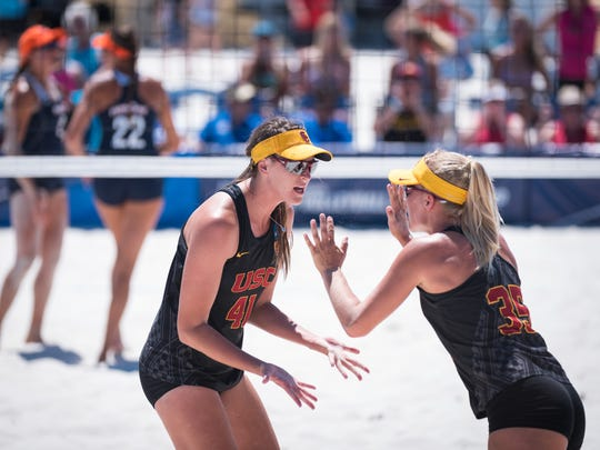 Terese Cannon, left,  celebrates USC beach volleyball's