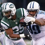 Tennessee Titans defensive end Jurrell Casey (99) tackles New York Jets' Bilal Powell (29) during the second half Sunday in East Rutherford, N.J.