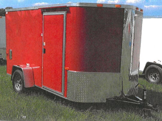 A utility trailer loaded with tools was reported stolen